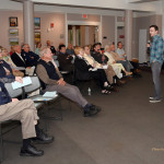 Andrew Hemmingway Addresses Meeting